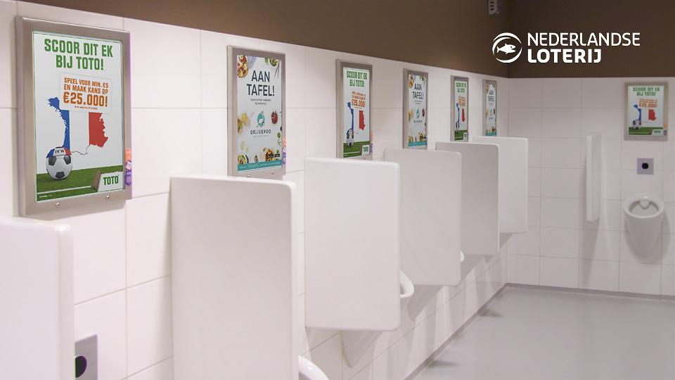 Altermedia Nederlandse Loterij Toto Toiletreclame WCreclame Toiletmedia Washroom media