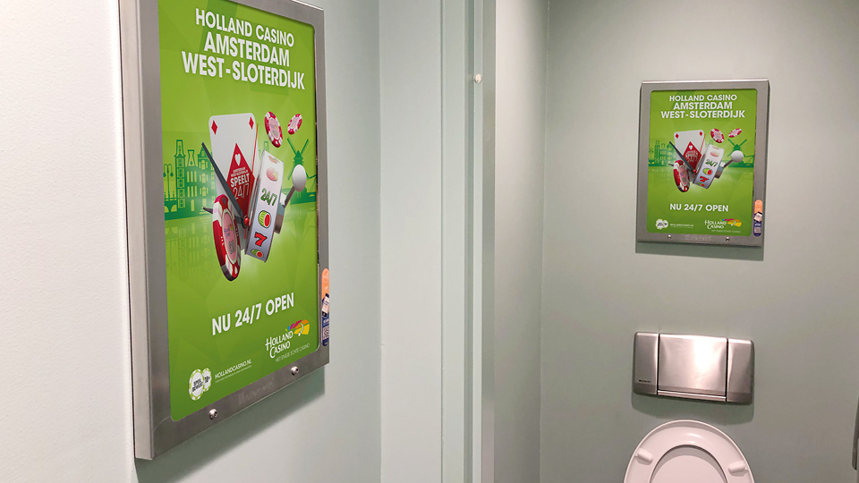Altermedia Holland Casino Amsterdam-West WCreclame Toiletmedia Washroom media