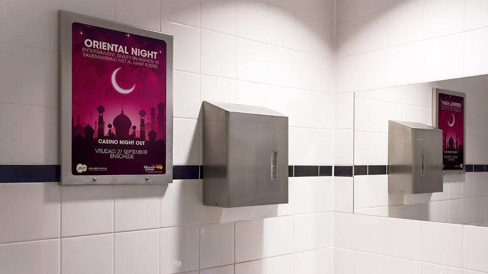 Altermedia Holland Casino Enschede WCreclame Toiletmedia Washroom media